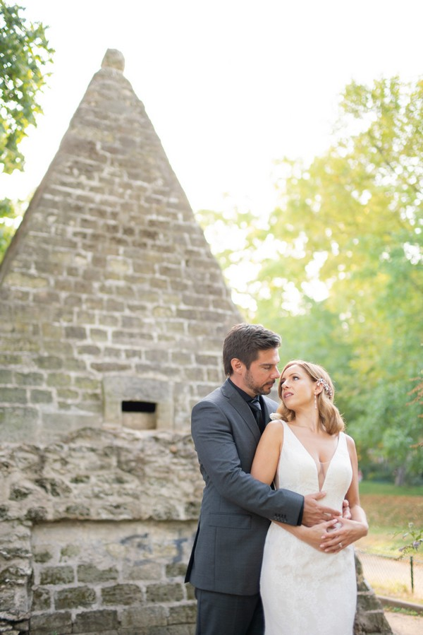 Bride and groom in front of egyptian pyramid in Parc Monceau Paris