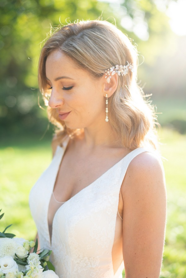 Bride's drop diamond earrings and crystal hair pin on side of hair