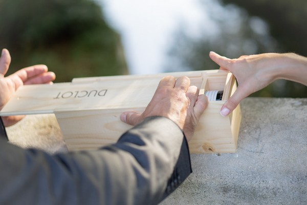 Red wine and keep sakes being sealed into wooden wine box by bride and groom