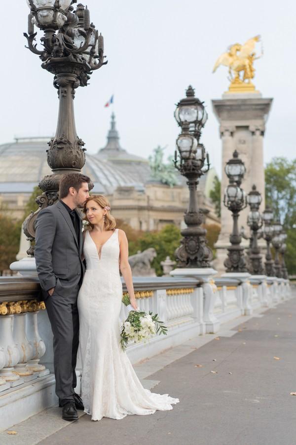 bride and groom on Alexander III bridge in Paris