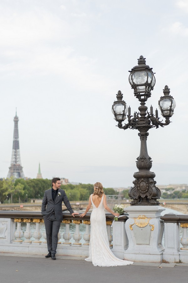 Bride and groom take in the view of the River Seine and the Eiffel Tower