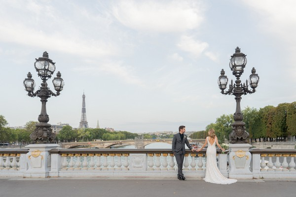 bride and groom look out across the Seine River