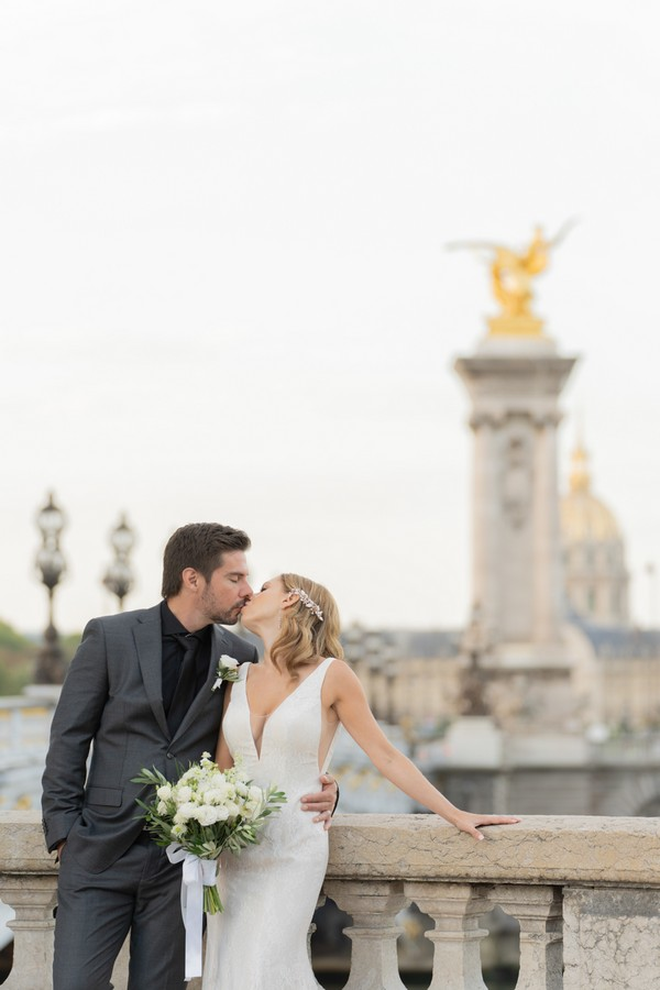 bride and groom share a kiss