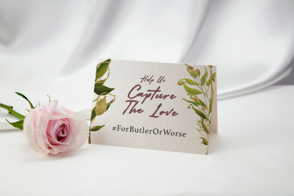 #ForButlerOrWorse on wedding table placeholder with pink rose