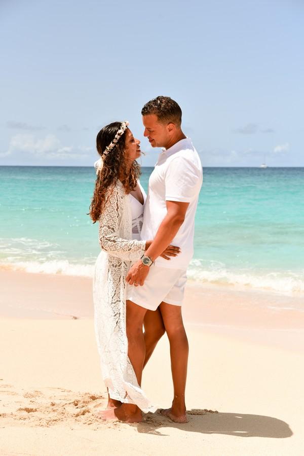 Bride and groom wear white in sand for Elopement Wedding In St Maarten