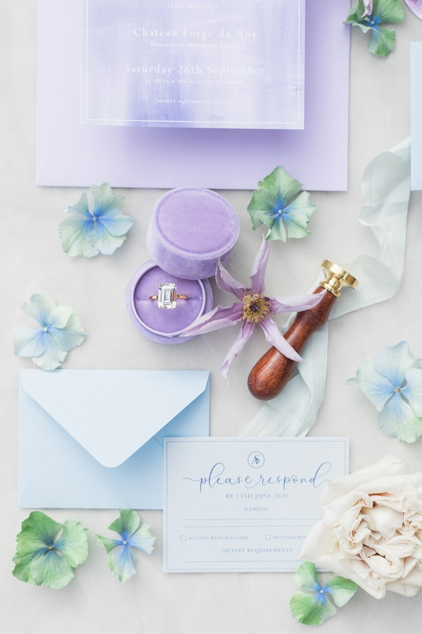 Monet Inspired Garden Wedding Flat Lay of Wedding Stationery and Rings in Pastel Purples, Greens and Blues