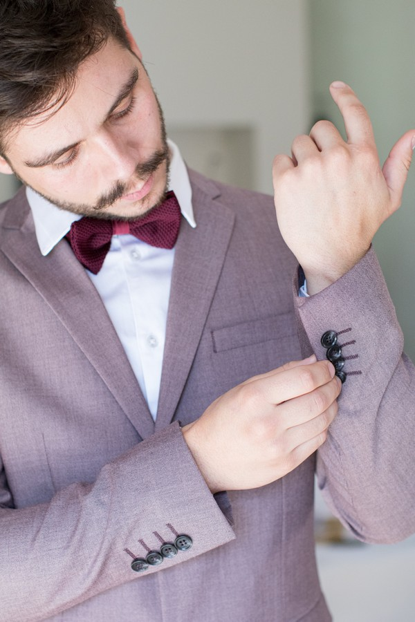 purple suit for fall wedding at Domaine des Moures