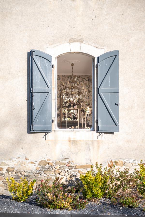 Wooden Shutter Windows in Blue Look In On Wedding Ceremony