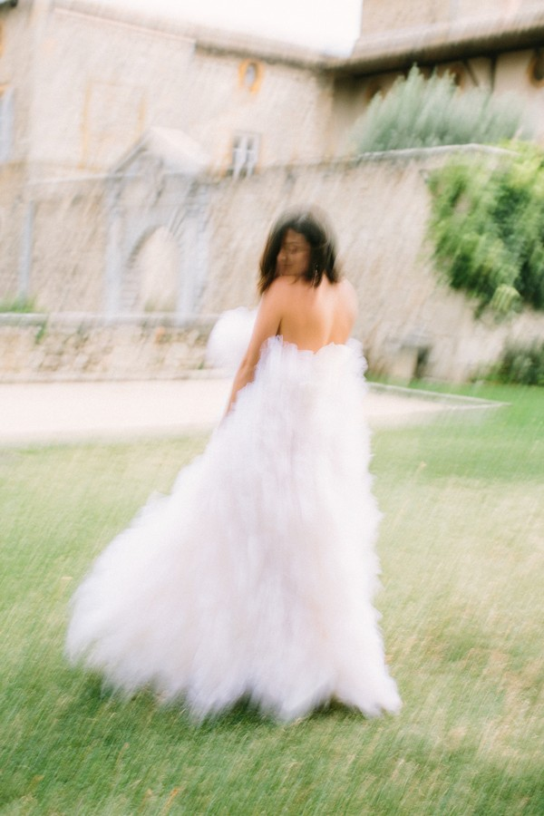 """Bride in blurry picture in fluffy full gown says """"Yes"""" during Covid"""