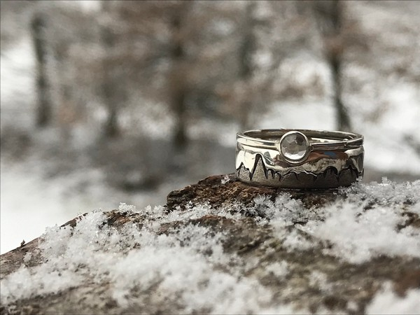tailor-made wedding rings crafted by a local Chamonix artist made with a clear quartz crystal